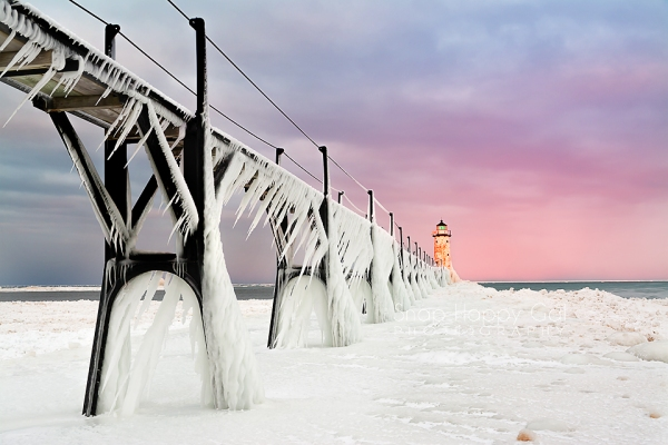 Photo: Pink sunrise, pier ice formations, Manistee Lighthouse