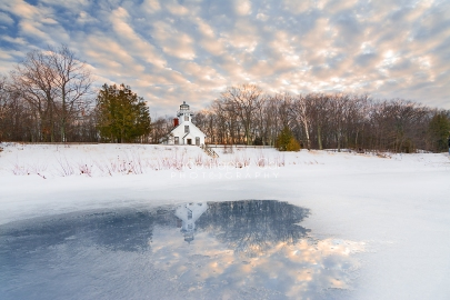 Photo: Old Mission Point Lighthouse Reflects in a winter puddle