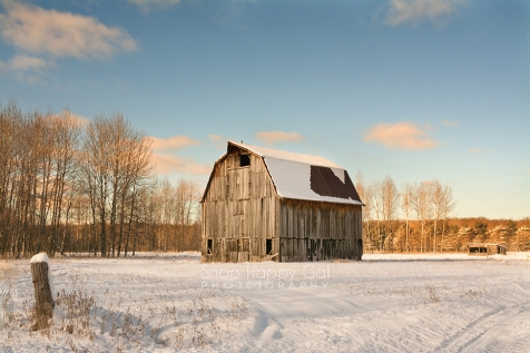 Photo: An old Michigan country barn basks in rosy light on a snowy winter morning