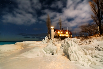 Photo: Starry skies and ice formations adorn the beautiful Point Betsie Lighthouse