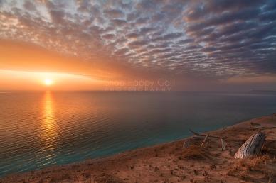 Photo: golden sunset, purple quilted sky, Lake Michigan/Sleeping Bear Dunes