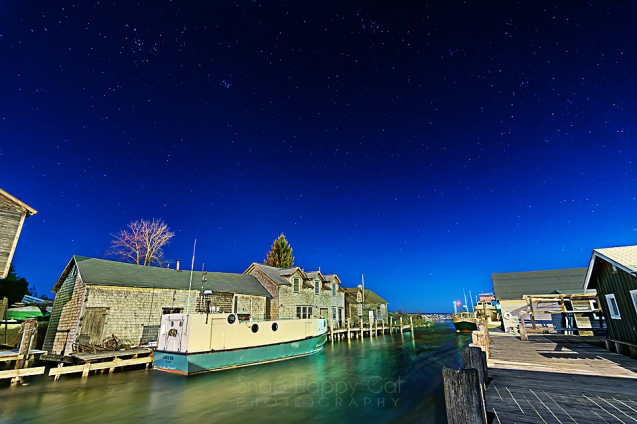 Photo: Fishtown/Leland, Michigan under a moonlit, starry night