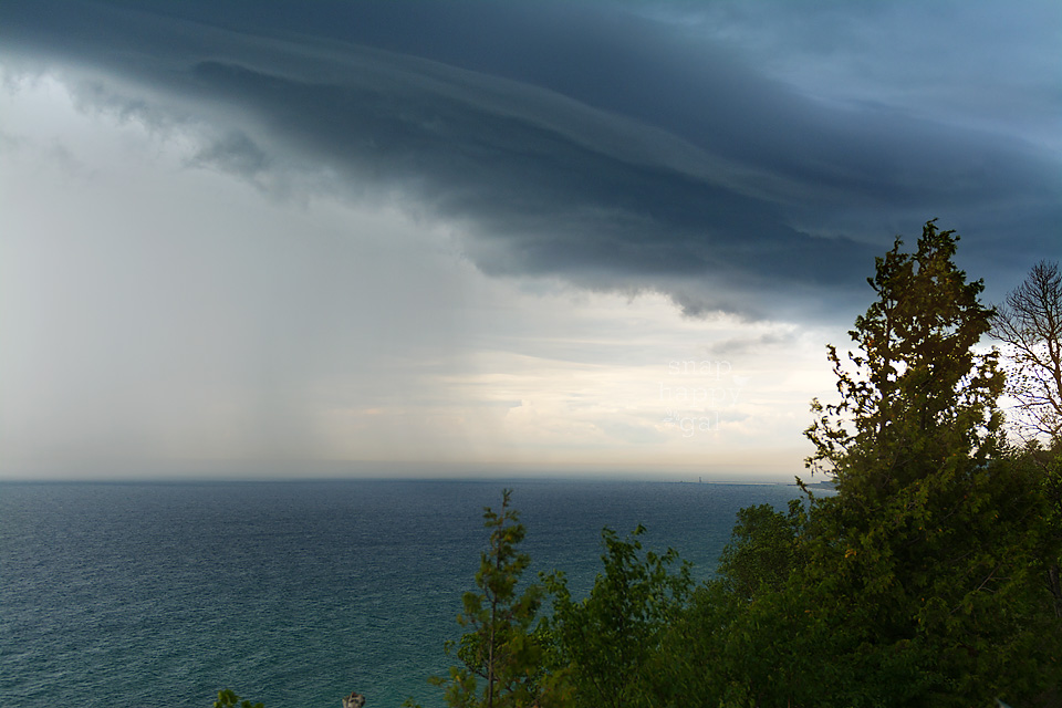 Photo: A storm front drops rain over Lake Michigan in Frankfort