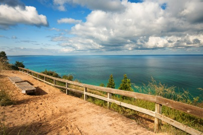 Puffy clouds float over Platte Bay, Lake Michigan, as viewed from Empire Bluffs