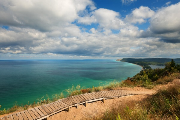 Summery skies prevail at the Lake Michigan overlook at Empire Bluffs