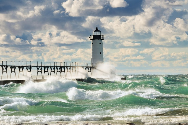 An autumn gale drives crashing waves into the Manistee Lighthouse