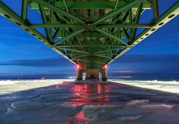 The Mackinac Bridge from below, as seen on an icy winter evening