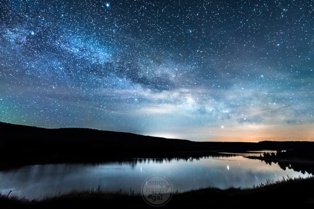 The core of the Milky Way hovers above the placid waters of North Bar Lake in the Sleeping Bear Dunes National Lakeshore