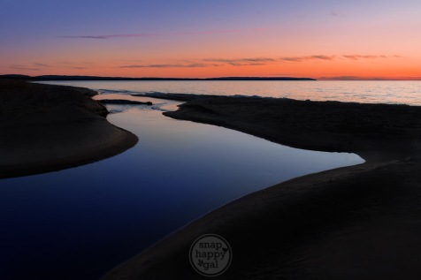 Esch Beach in silhouette with Otter Creek reflecting faint sunset afterglow