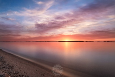 Calm waters and warm colors over Traverse City's East Bay (Lake Michigan)