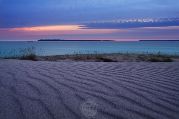 Purple sky and lines of sand above Lake Michigan in the Sleeping Bear Dunes