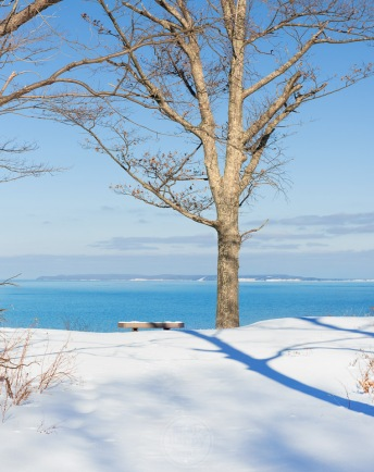 Blue sky, blue shadows, and blue Lake Michigan at Alligator Hill in the winter in the Sleeping Bear Dunes