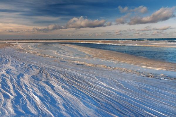 Drifting snow forms laminar layers along the Platte River in Michigan's Sleeping Bear Dunes