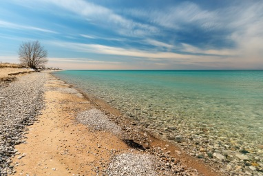 Vibrant turquoise waters and tumbled stones in Lake Michigan