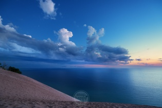 Dramatic clouds and twilight over Lake Michigan from atop a Sleeping Bear Dunes overlook