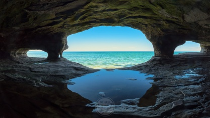 """A sunny view of Lake Superior from inside a """"sea cave"""""""