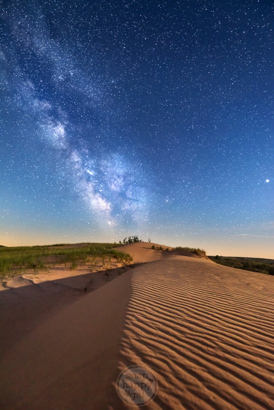 The core of the Milky Way burns over the wavy shifting sands at Sleeping Bear Point