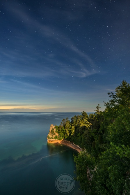 Moonlight and twilight collide in this starry night image of Miners Castle in the Pictured Rocks National Lakeshore; Upper Peninsula, Michigan