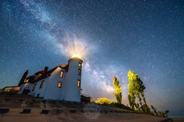 The Milky Way arcs over the Point Betsie Lighthouse on Lake Michigan