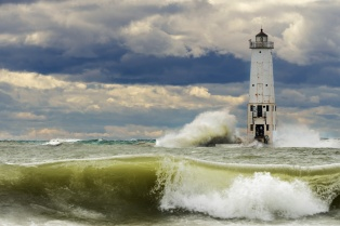 Rolling, crashing waves buttress the Frankfort Lighthouse on Lake Michigan