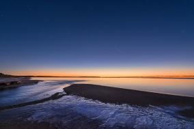 icy-beach-lake-michigan-twilight-stars-sunset-01191281