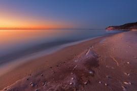 peace-placid-lake-michigan-beach-sunset-empire-bluffs-01191256